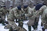 British Royal Marines learn warm-up exercises to prevent frostbite—a priori...