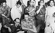 <b>Members</b> of the Indonesian army discuss strategy on the night of Oct. 1, 196...