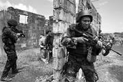Philippine National Police officers train with members of the U.S. <b>military</b>...