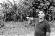 A local farmer points to where he fled from <b>security</b> forces.   A local farm...