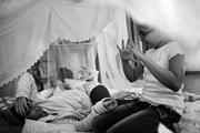 Ohoud, an art director in Jeddah, plays with her daughter in a fort she bui...