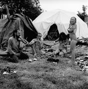 <b>Members</b> of a family play the violin and flute outside their tent at the Gla...